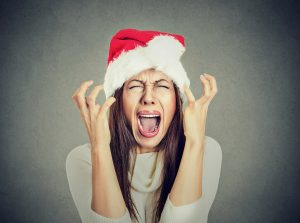 stellar-adjusting-safe-home-decorating-tips-for-the-holidays-woman-screaming-in-santa-hat